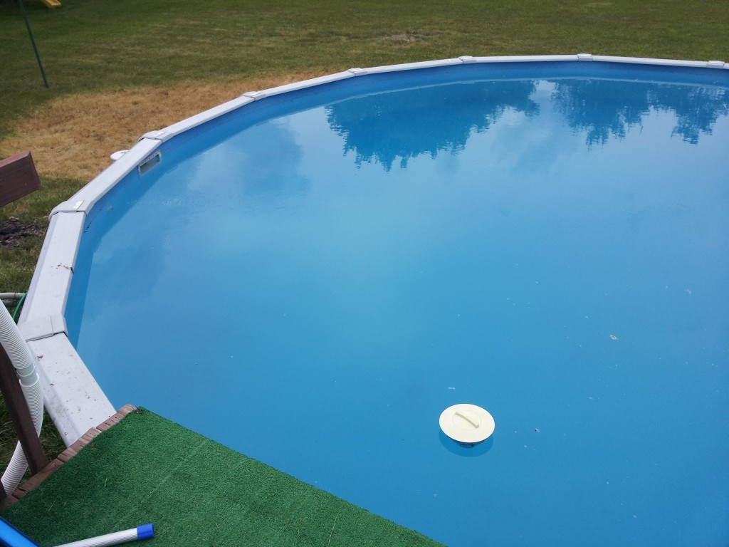 The aboveground pool is almost clean